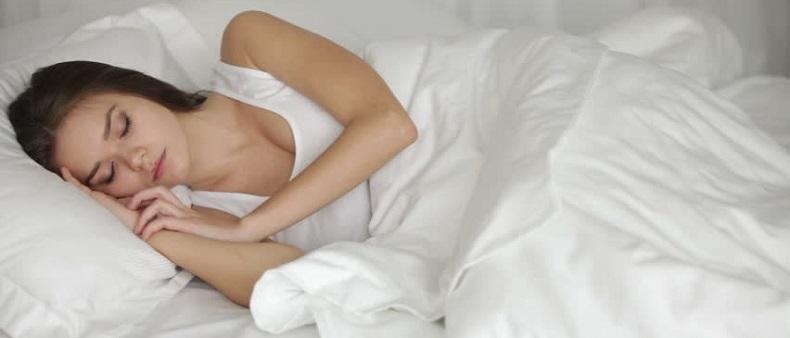 Girl sleeping after taking melatonin